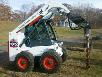 Country Landscaping - Bobcat with Auger