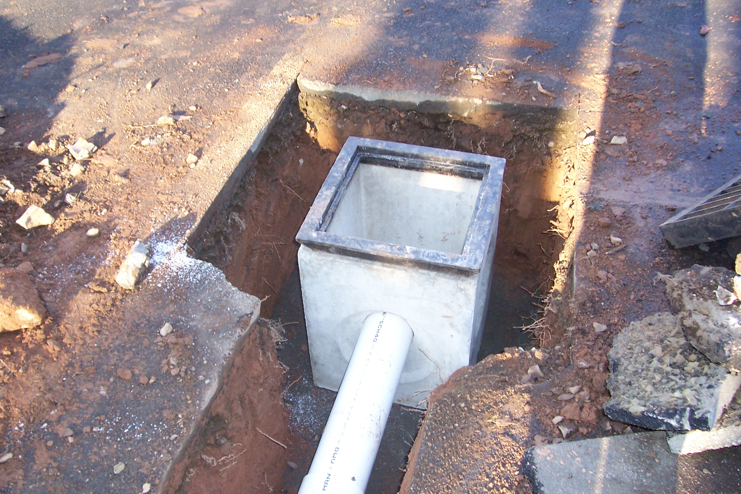 Catch basin installation country landscaping llc for Yard drainage basin