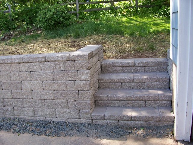 Replacing a Railroad Tie Wall | Country Landscaping, LLC