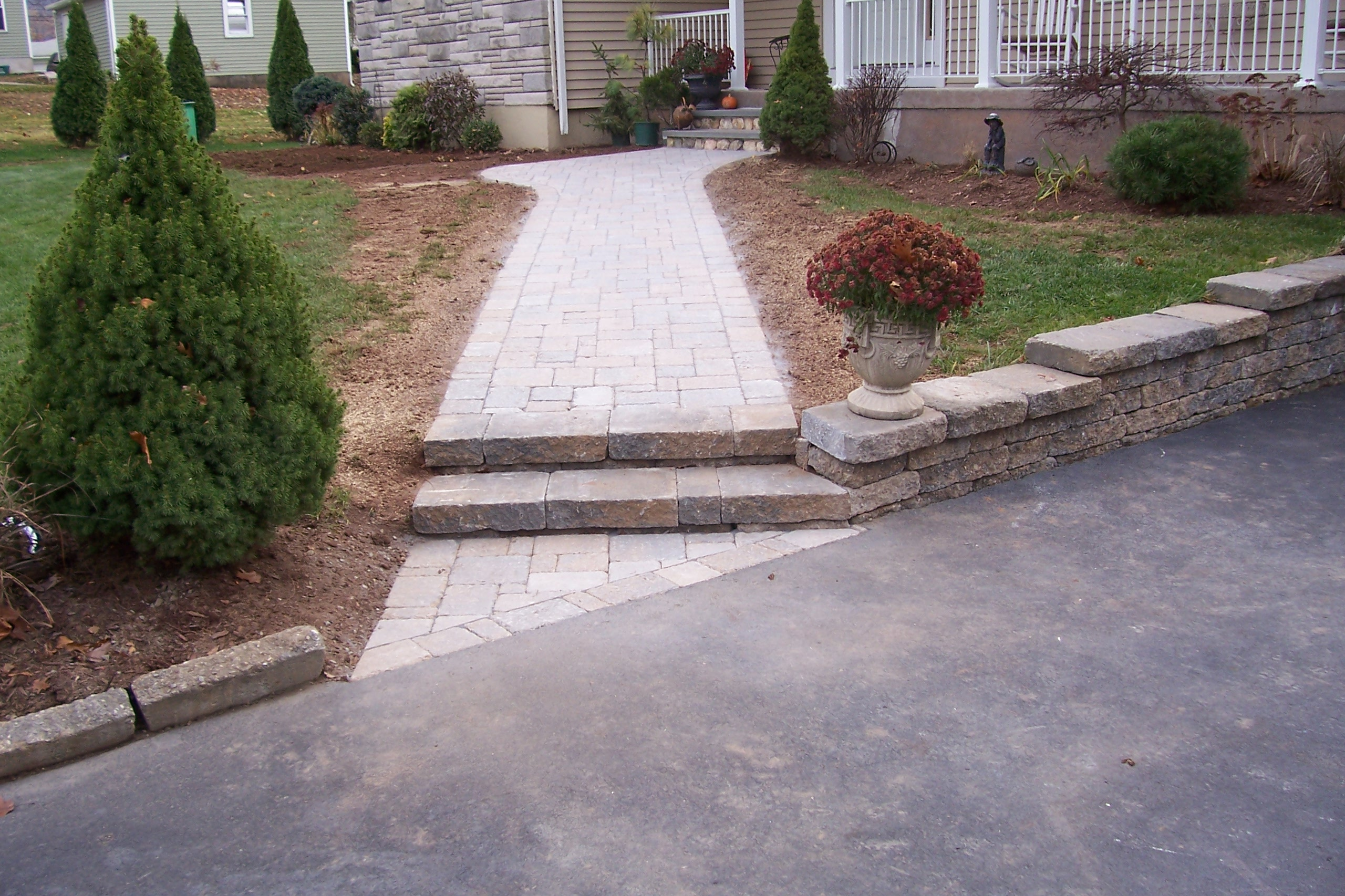retaining wall along a driveway country landscaping llc